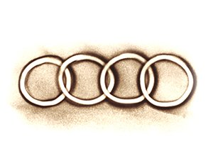 Audi Logo in Sand gemalt - Version 1