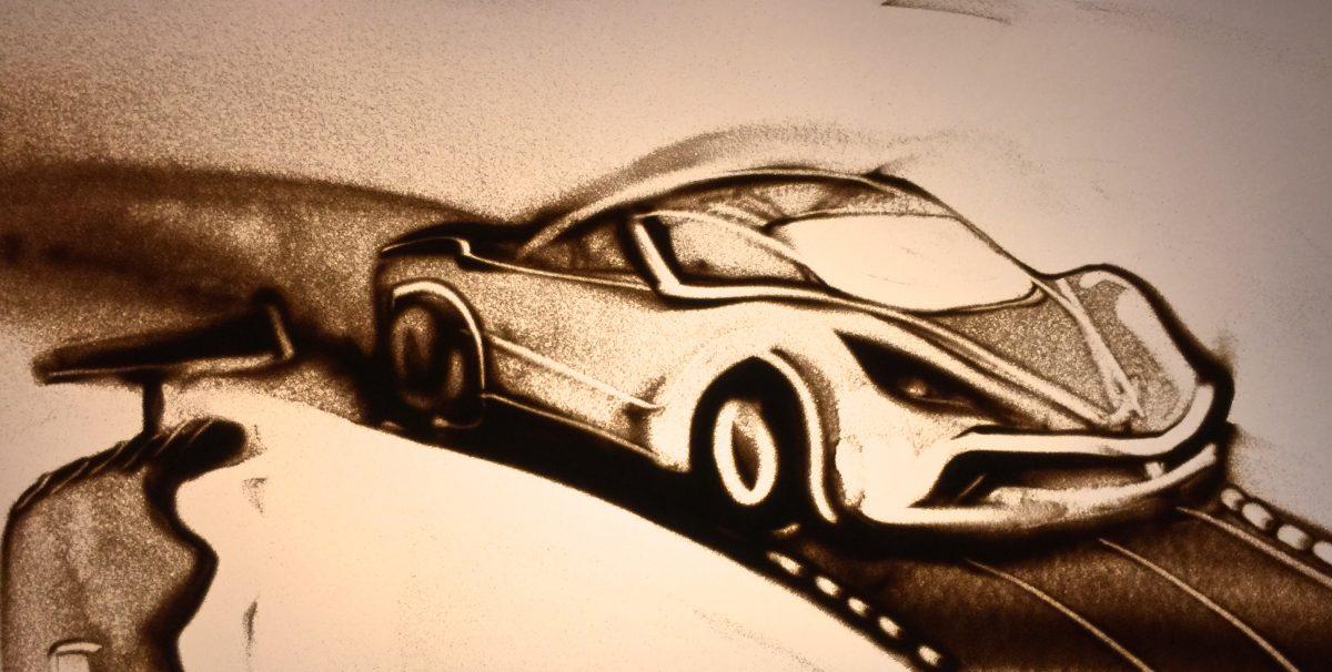 Carrera Rennauto in Sand gemalt