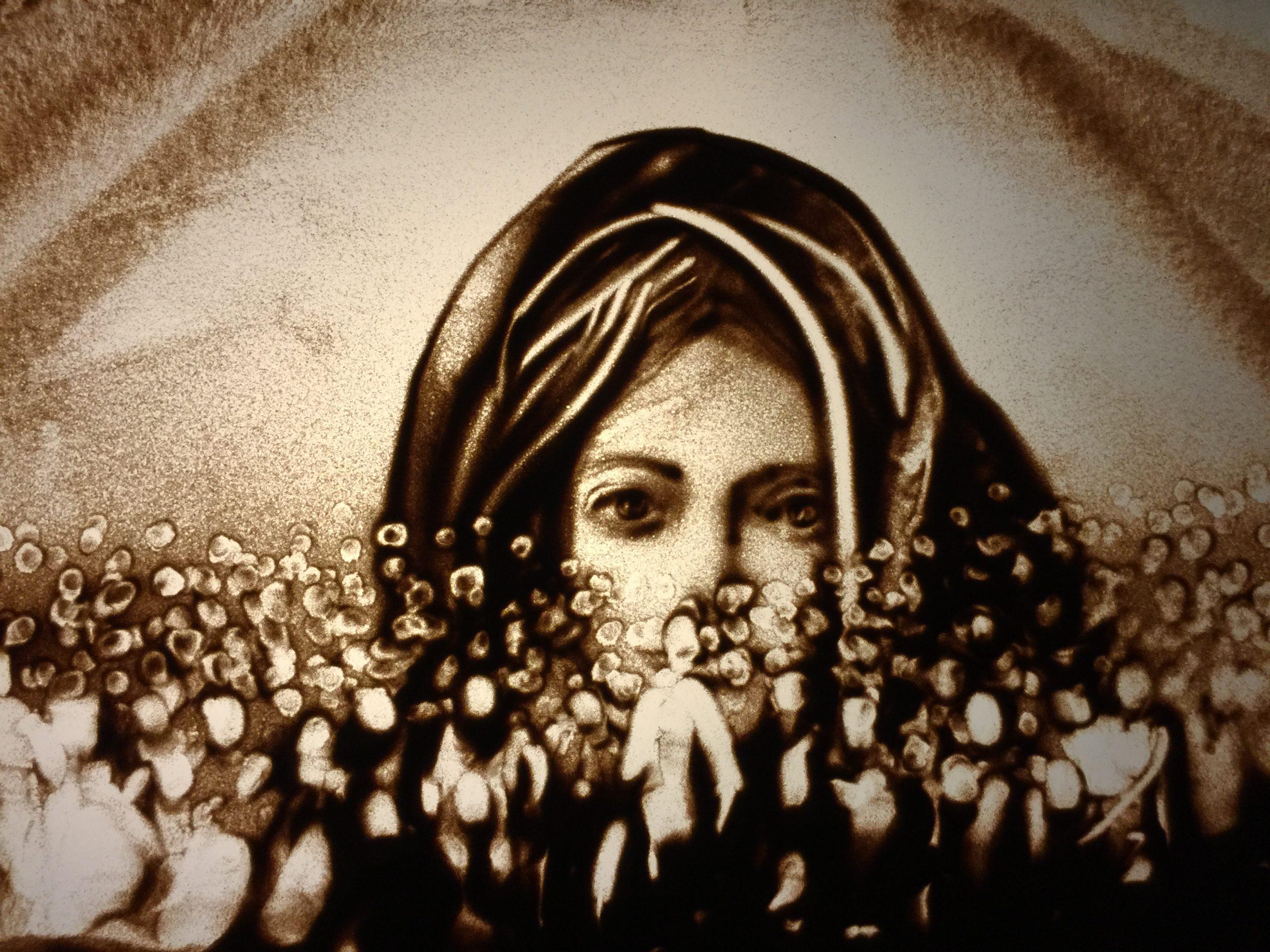 Sandbild von Frau mit Kopftuch