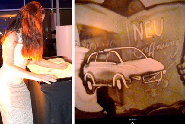 Sandmalerei Auftritt für Volvo