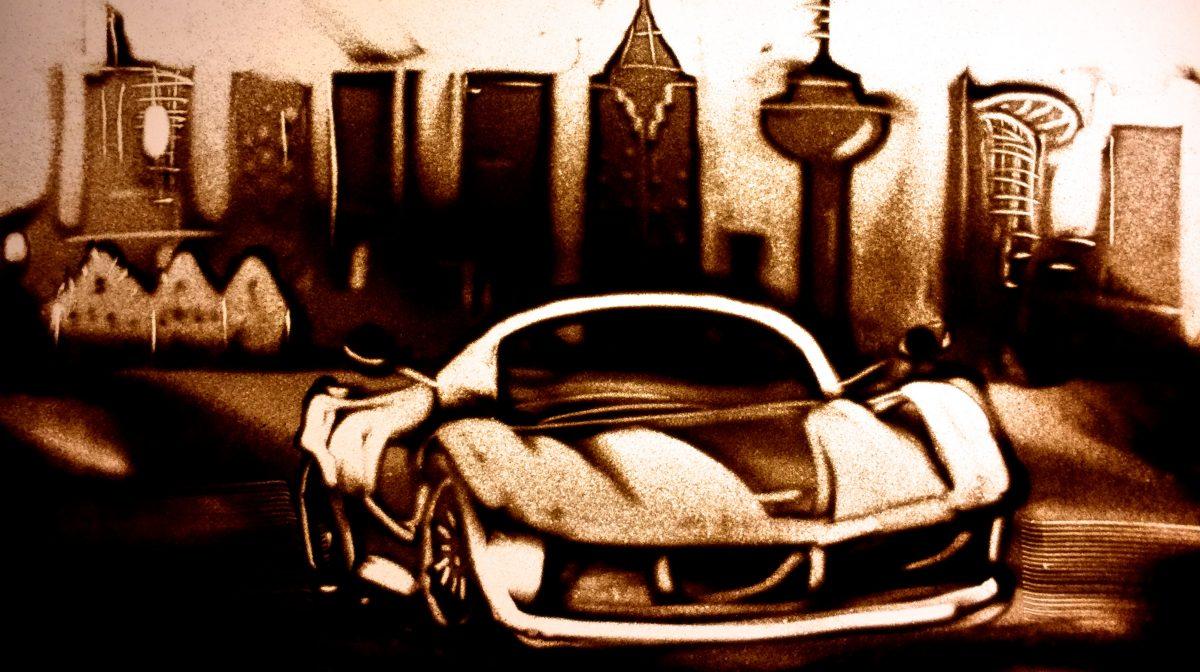 Sandmalerei Ferrari Rennwagen